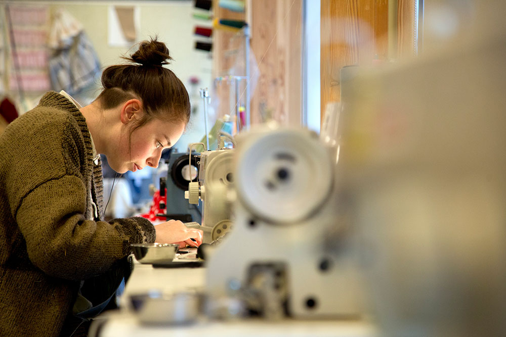 Student sewing in costuming studio