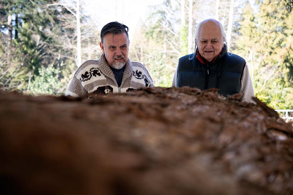 Elder Ernie George and David Kirk with legacy canoe