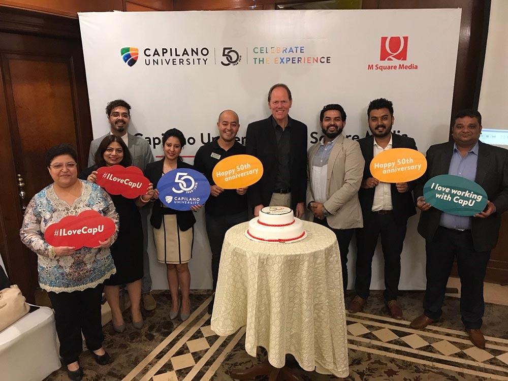 Cristian Cano celebrating CapU's 50th