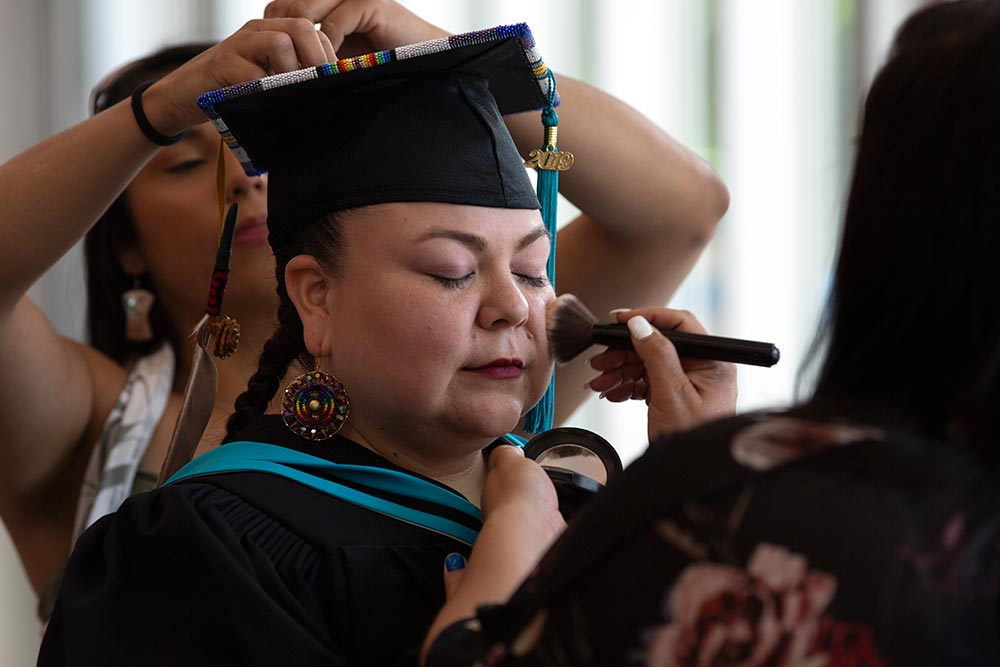 Graduating student prepping for convocation